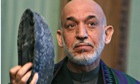 Taliban urge Afghan president Hamid Karzai to reject US security deal