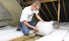 Man laying loft insulation