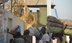 Residents of Juba arrive at the UN compo