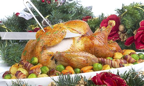 Carving a christmas turkey with vegetables