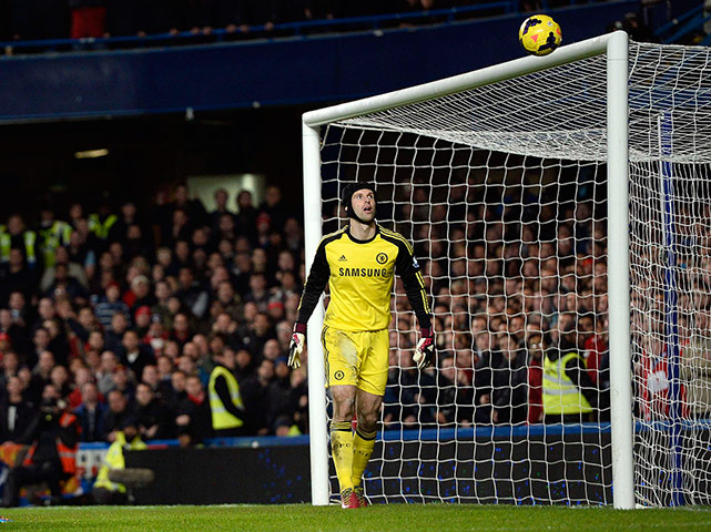 football: Chelsea goalkeeper Cech watches as the ball hits the bar