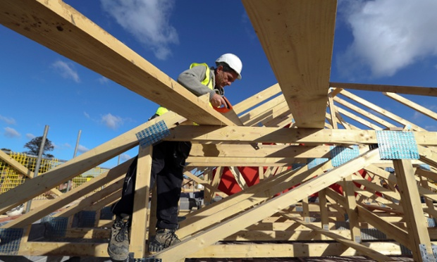 A builder at a new residential home at a Bellway site in Northampton, UK.