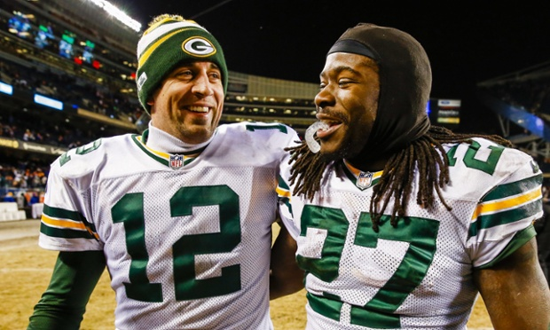 Green Bay Packers quarterback Aaron Rodgers giggles with teammate Eddie Lacy after they helped defeat the Chicago Bears to take the NFC North division title. EPA/TANNEN MAURY