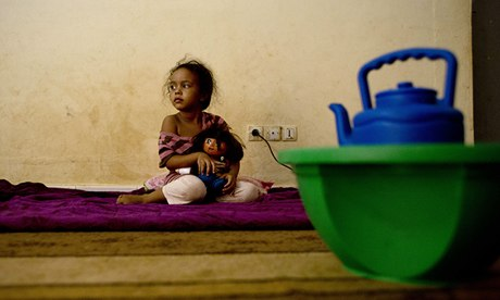 A displaced Malian girl from Timbuktu at her family's refuge in Bamako