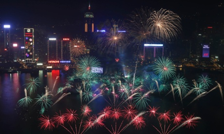 Fireworks explode at the Hong Kong Convention and Exhibition Centre over the Victoria Harbor during New Year's celebrations in Hong Kong, Wednesday, Jan. 1, 2014.