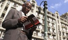 Egyptian man reads constitution