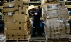 Pedraza Gonzalez sorts packages at the FedEx hub at Los Angeles International Airport