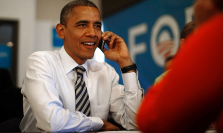 Obama talking on mobile phone
