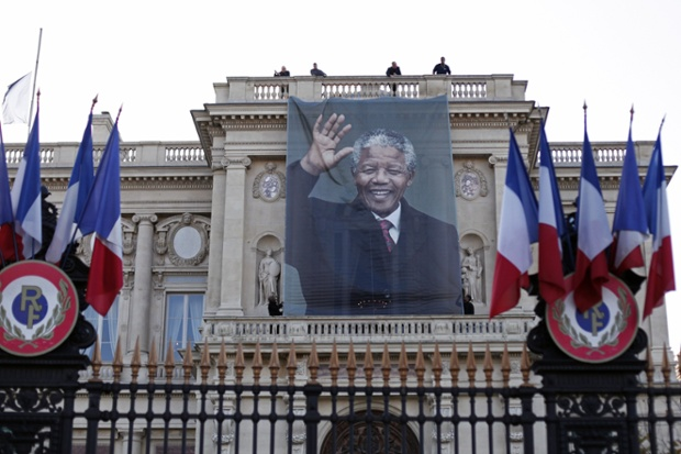 A banner with the image of Mandela is hung outside the Quai d'Orsay foreign Ministry, in Paris.