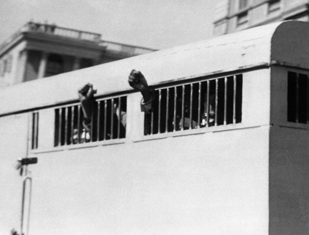 The prison van containing eight men, including Mandela, leaves the Palace of Justice in Pretoria after the group was sentenced to life imprisonment in the Rivonia trial in 1964.