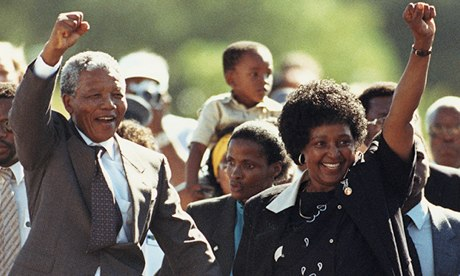 Nelson Mandela and wife Winnie salute well-wishers upon his release from Victor Verster prison