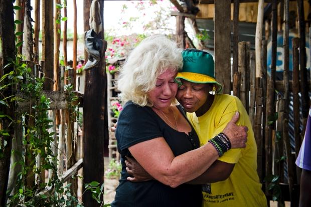 Jeanne Silver and Ninifa Mothoa of Freedom Walls mourne the death of Mandela in Johannesburg.