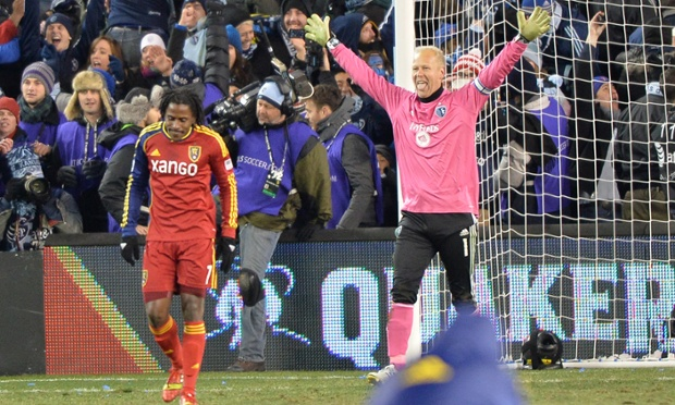 Sporting KC goalkeeper Jimmy Nielsen celebrates after Real Salt Lake's Lovel Palmer missed the decisive penalty of the 2013 MLS Cup at Sporting Park