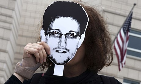 Woman holds Edward Snowden portrait outside US embassy, Berlin 4/7/13