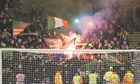 celtic fans throw flares at motherwell