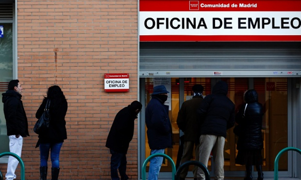 People wait in line to enter a government-run employment office in Madrid this month.
