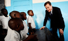 David Cameron meets pupils in Monrovia, Liberia, before the UN conference on development goals