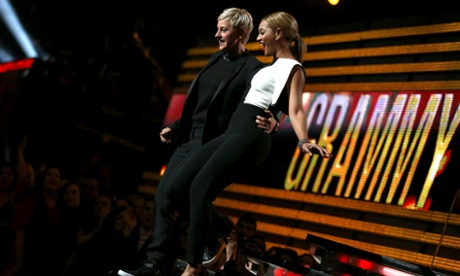 Comedian Ellen DeGeneres and singer Beyoncé appear on stage at the e 55th Grammy awards.