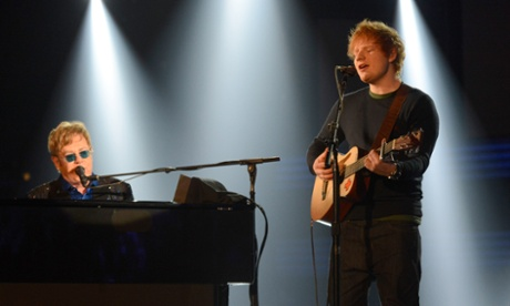 Elton John and Ed Sheeran perform at the 2013 Grammy awards in Los Angeles.