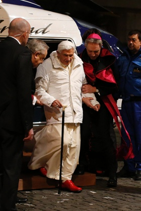 Pope Benedict XVI is helped as he arrives to attend a meeting in Rome last week.