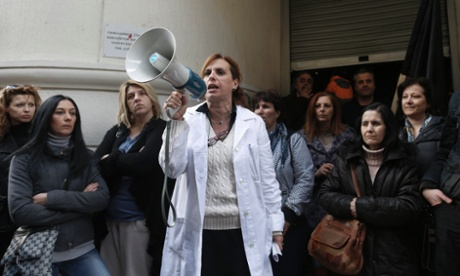 Greek mental health workers take part in a rally against job cuts and reforms in their sector outside the Health Ministry in Athens today.