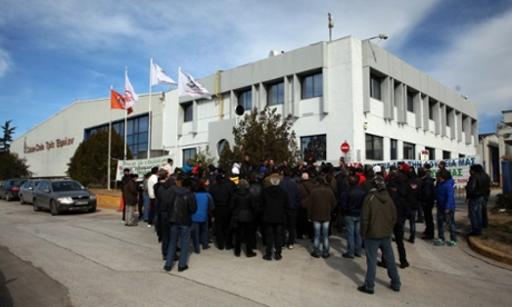 Employees of the Coca-Cola company stand outside of their factory in Thessaloniki last week during a 24-hour strike to protest against layoffs