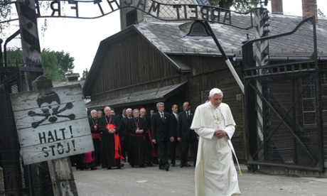 FILE - In this May 28, 2006 file photo, Pope Benedict XVI walks through the gate of the former Nazi concentration camp Auschwitz in Oswiecim, Poland, to pay his respects to the Holocaust victims. Sign at left reads