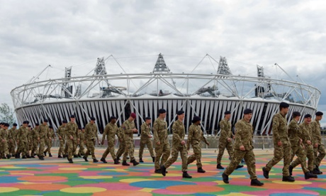 Members of the Armed Forces are shown around the site of the London 2012 Olympics in east London on July 15, 2012.