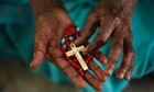 And here an Indian Catholic woman holds a rosary and prays on Ash Wednesday at Saint Mary's Basilica in Hyderabad.