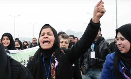 An Afghan woman shouts during a march calling for the end of violence against women in Kabul. Photograph: AP Photo/Musadeq Sadeq