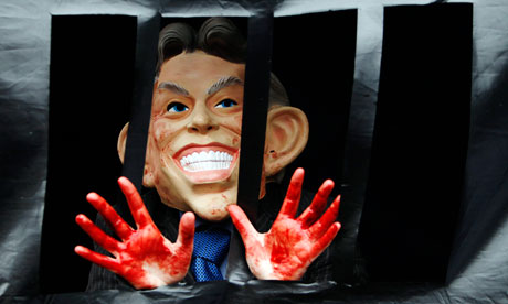 a demonstrator wears a Tony Blair mask outside the Chilcot Inquiry
