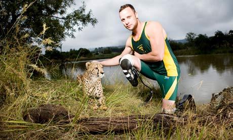 South African sprinter Oscar Pistorius in a publicity shoot with a cheetah