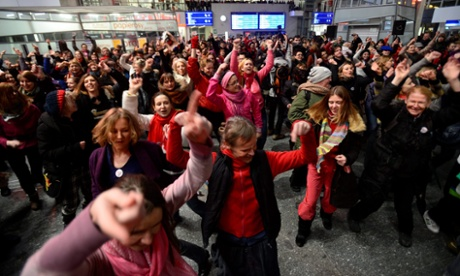 Polish women dance during the 'One Billion Rising' campaign at the Warsaw Central railway station.