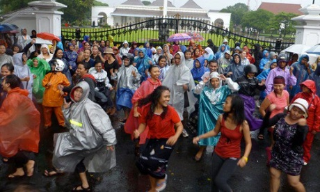 People in Jogjakarta, Indonesia dance through torrential downpours
