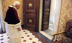 Pope Benedict XVI walks during a private
