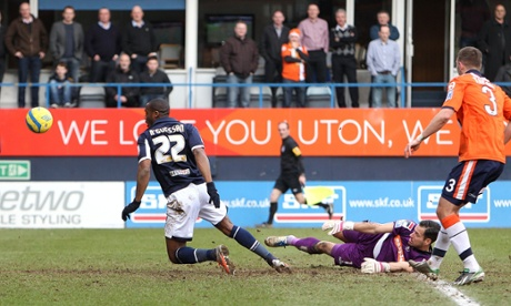 Millwall's Dany N'Guessan scores his team's third and final goal against Luton.