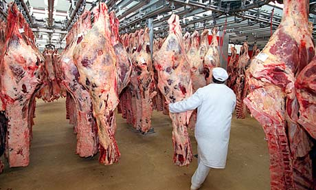 Beef carcasses at a wholesale meat market in Paris