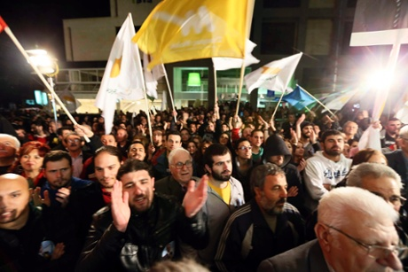 Supporters of Greek Cypriot presidential candidate Stavros Malas celebrate in Nicosia.