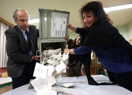 A handout picture released by the Cypriot Press and Information Office (PIO) shows a ballot box being emptied on February 17, 2013 in Nicosia, following the general elections.