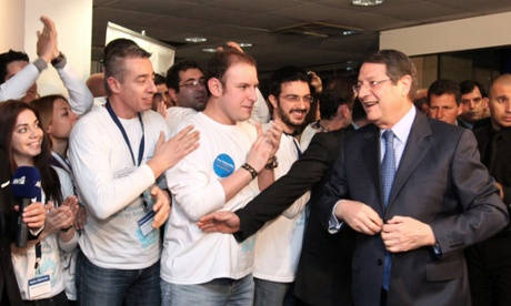 Greek Cypriot presidential candidate Nicos Anastasiades (R) arrives at the headquarters of the party in Nicosia, Cyprus, 17 February 2013.