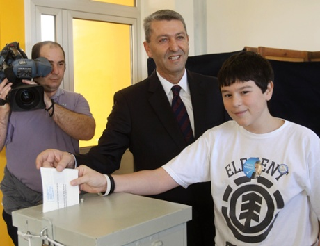 Cyprus independent presidential candidate George Lillikas and his son Orfeas cast a ballot at a polling station in Nicosia February 17, 2013.