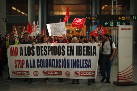 Iberia workers protest during a strike at Pablo Ruiz Picasso Airport in Malaga, southern Spain February 18, 2013. The banner reads,