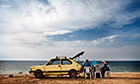 Trail Big Pic - Tanya Habjouqa: arab family on beach with yellow car