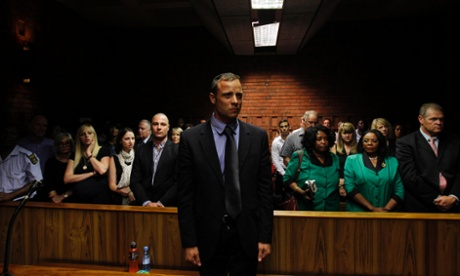Oscar Pistorius awaiting the start of court proceedings on 19 February 2013.