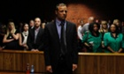 Oscar Pistorius awaits the start of court proceedings in the Pretoria Magistrates court.