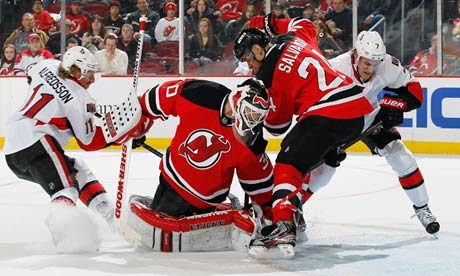 Martin Brodeur makes a save for the New Jersey Devils against the Ottawa Senators