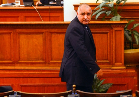 Bulgarian Prime Minister Boiko Borisov walks away after his speech in the Parliament in Sofia February 20, 2013.