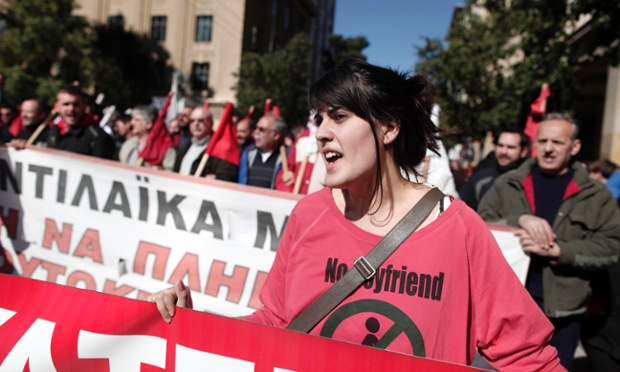 A member of pro-communist union PAME shouts slogans during a protest in Athens, Wednesday, Feb. 20, 2013.