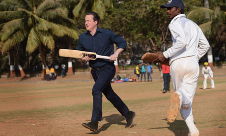 'Why didn't anyone pack me my whites?!' David Cameron plays cricket in India.