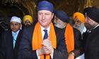 David Cameron aid budget military spending